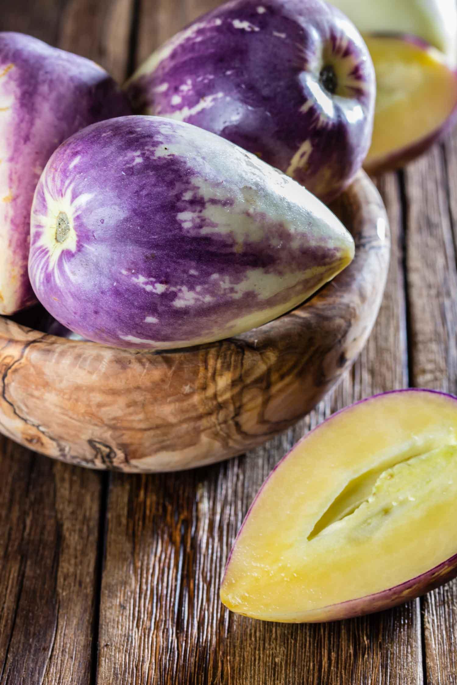 Peruvian fruits sweet cucumber. Pepino dulce or pepino melon on wooden background