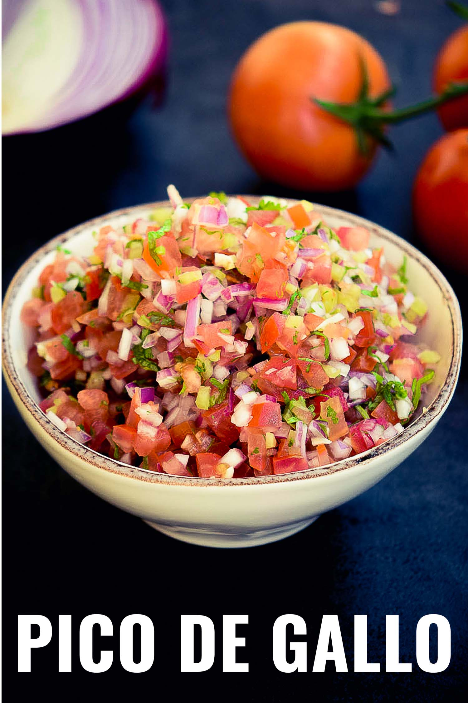 Mexican tomato salsa in a rustic bowl on a blue background