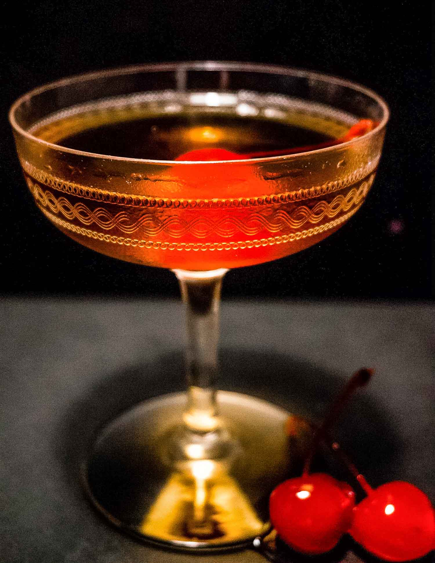 Manhattan Whiskey cocktail on a black background
