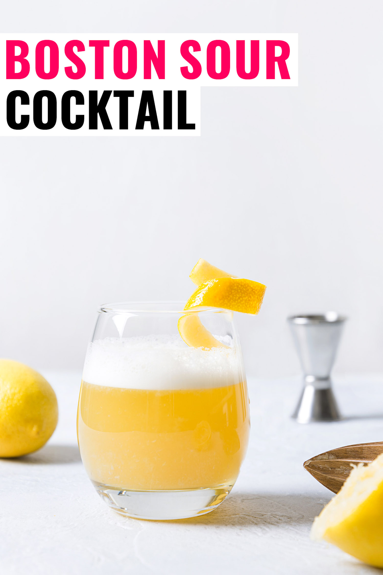 Boston sour cocktail - bourbon with lemon juice, sugar syrup and egg white in glass. Vertical orientation.