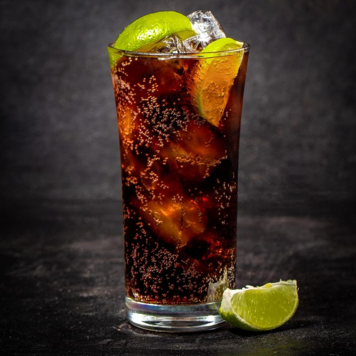 Charro negro cocktail with lime on a black background