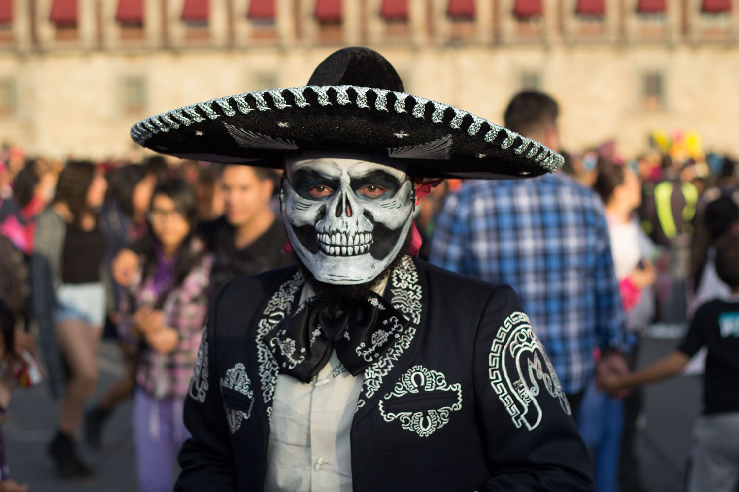 Man dressed up as Charro Negro character during day of the dead.