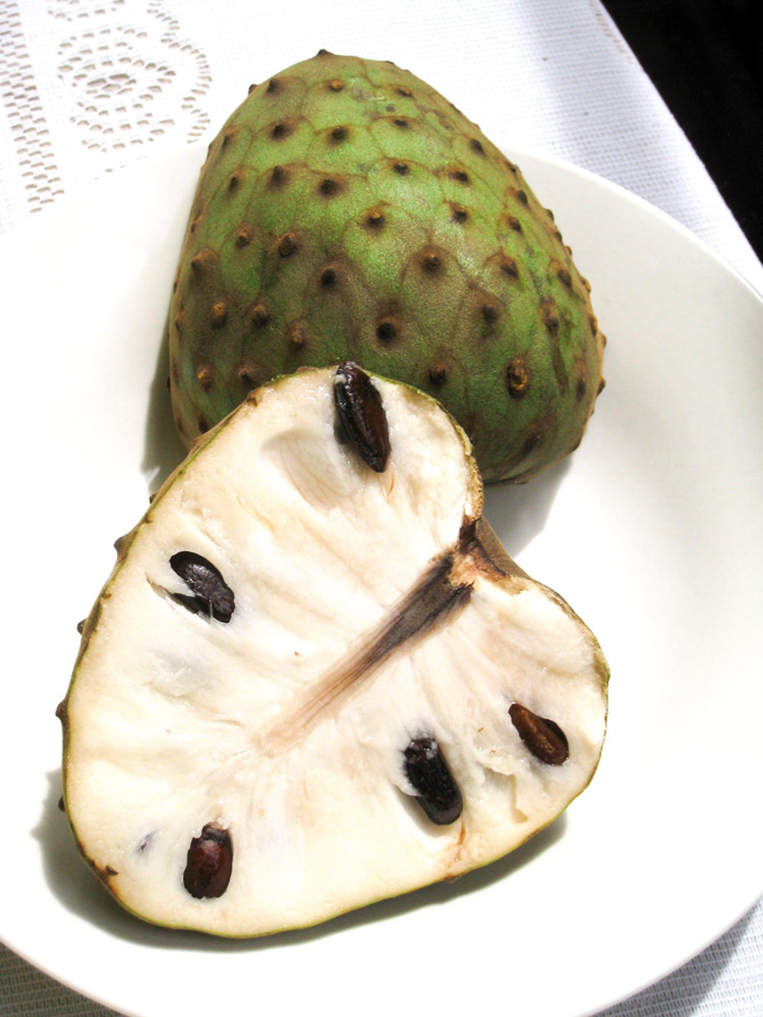 Cherimoya fruit in Hawaii on a white plate.