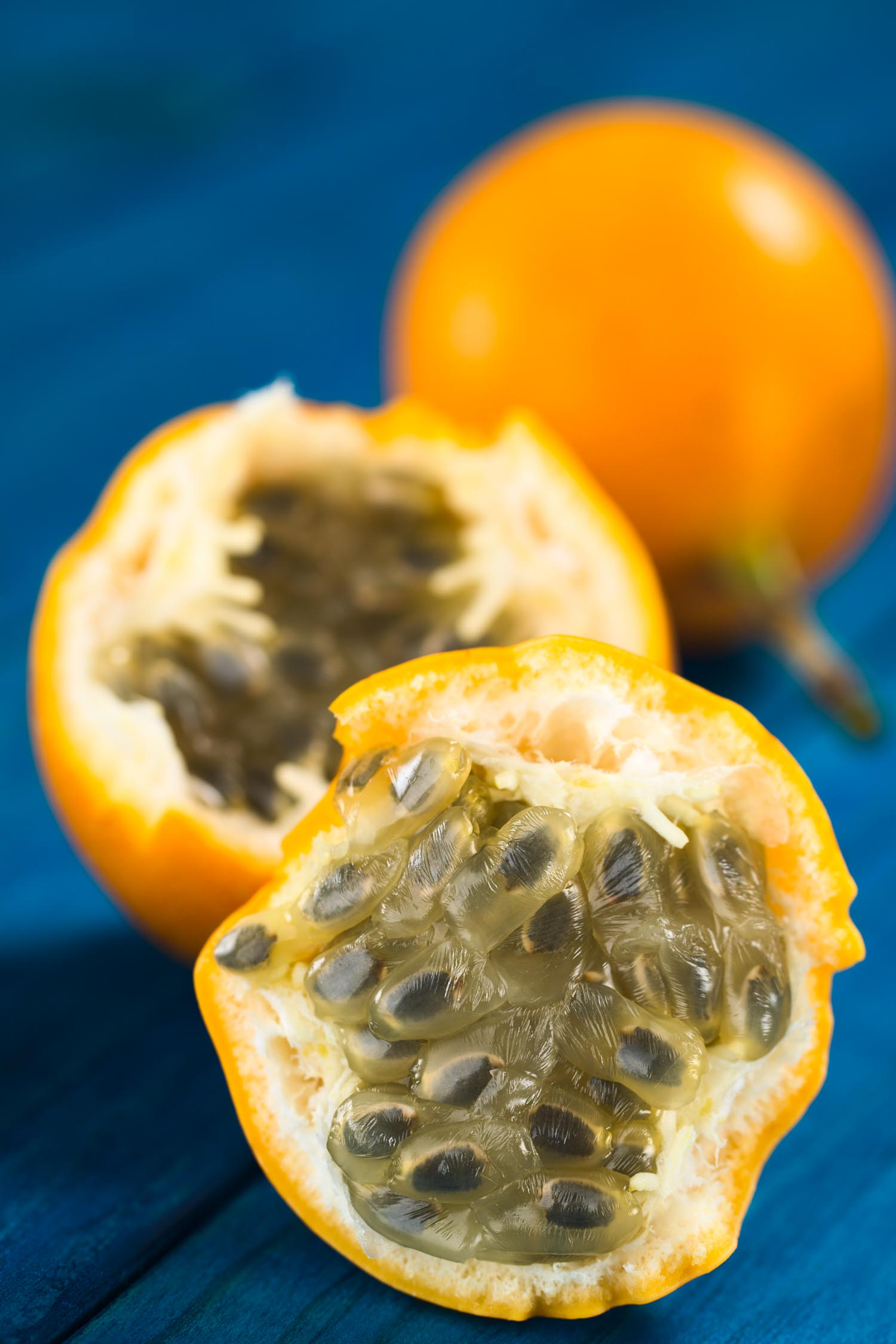 Fruit in Hawaii called lilikoi also known as sweet granadilla or grenadia (lat. Passiflora ligularis) fruit cut in half of which the seeds and the surrounding juicy pulp is eaten or is used to prepare juice