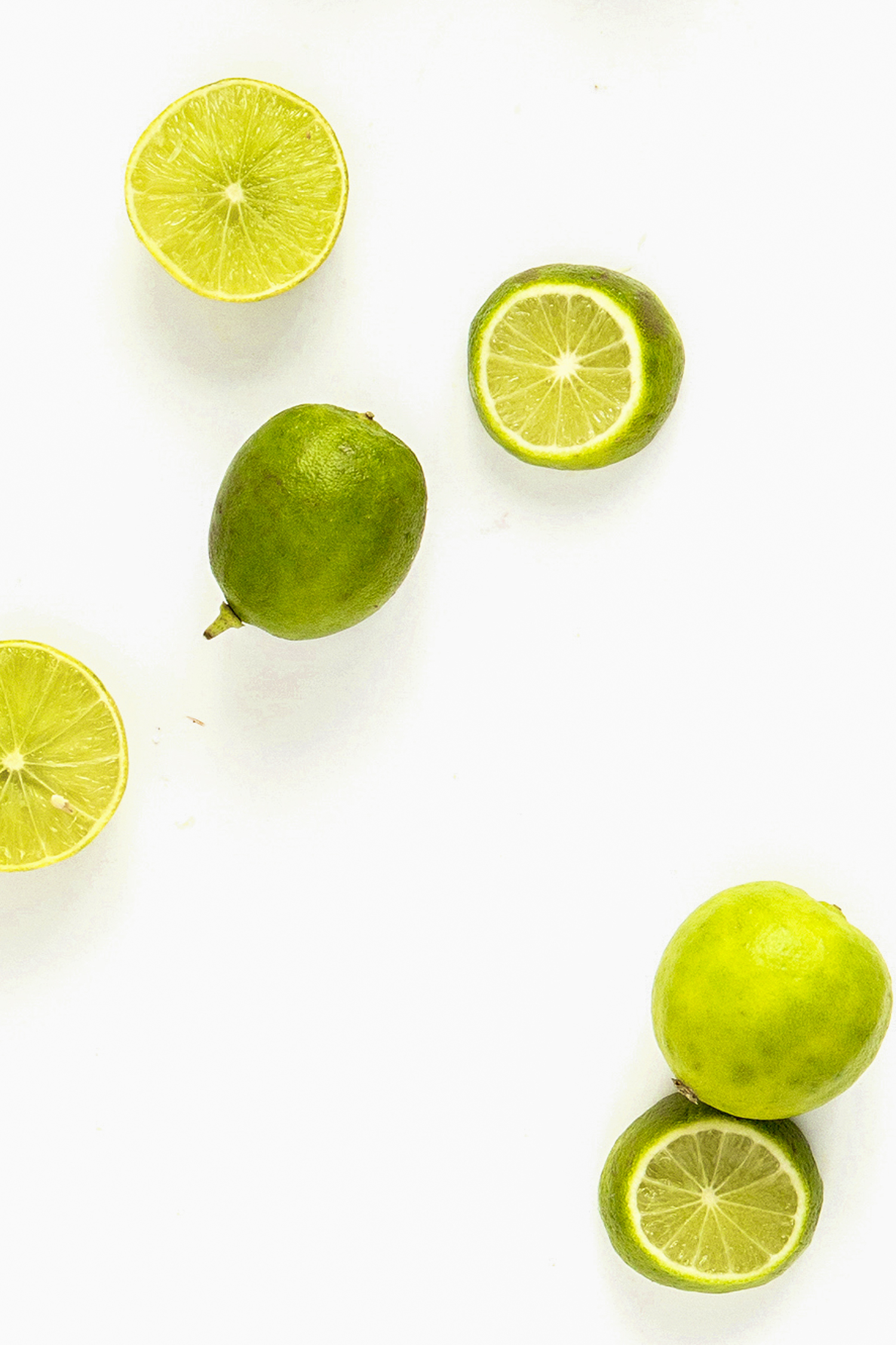 cut lime on a white background