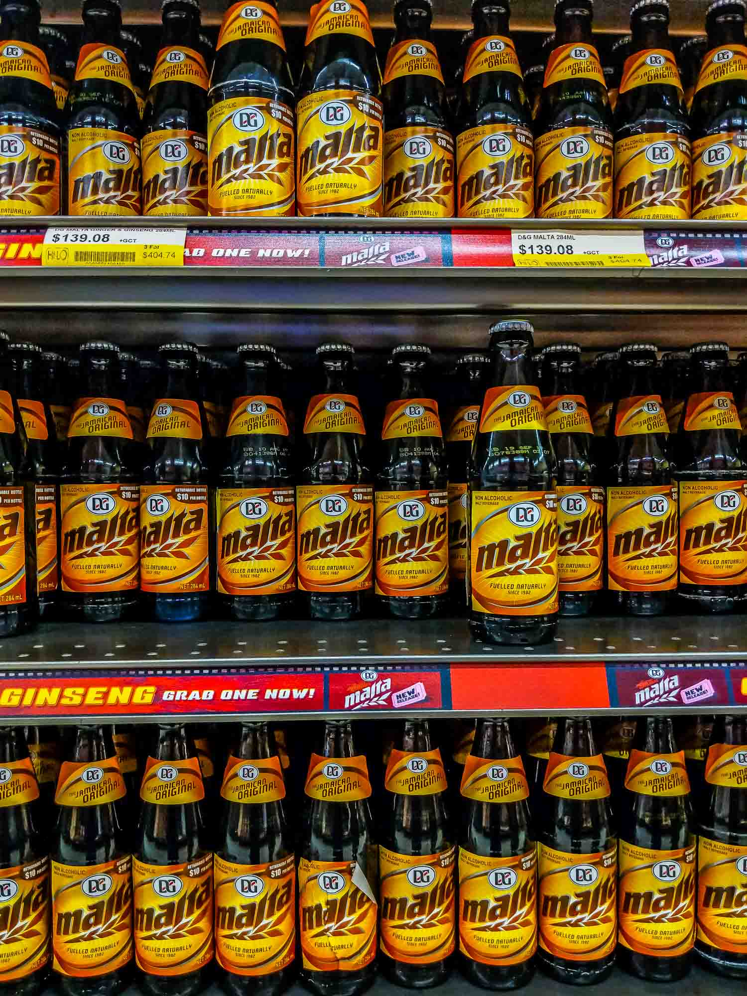 Drinks in Jamaica, a wall of Malta drink in a supermarket