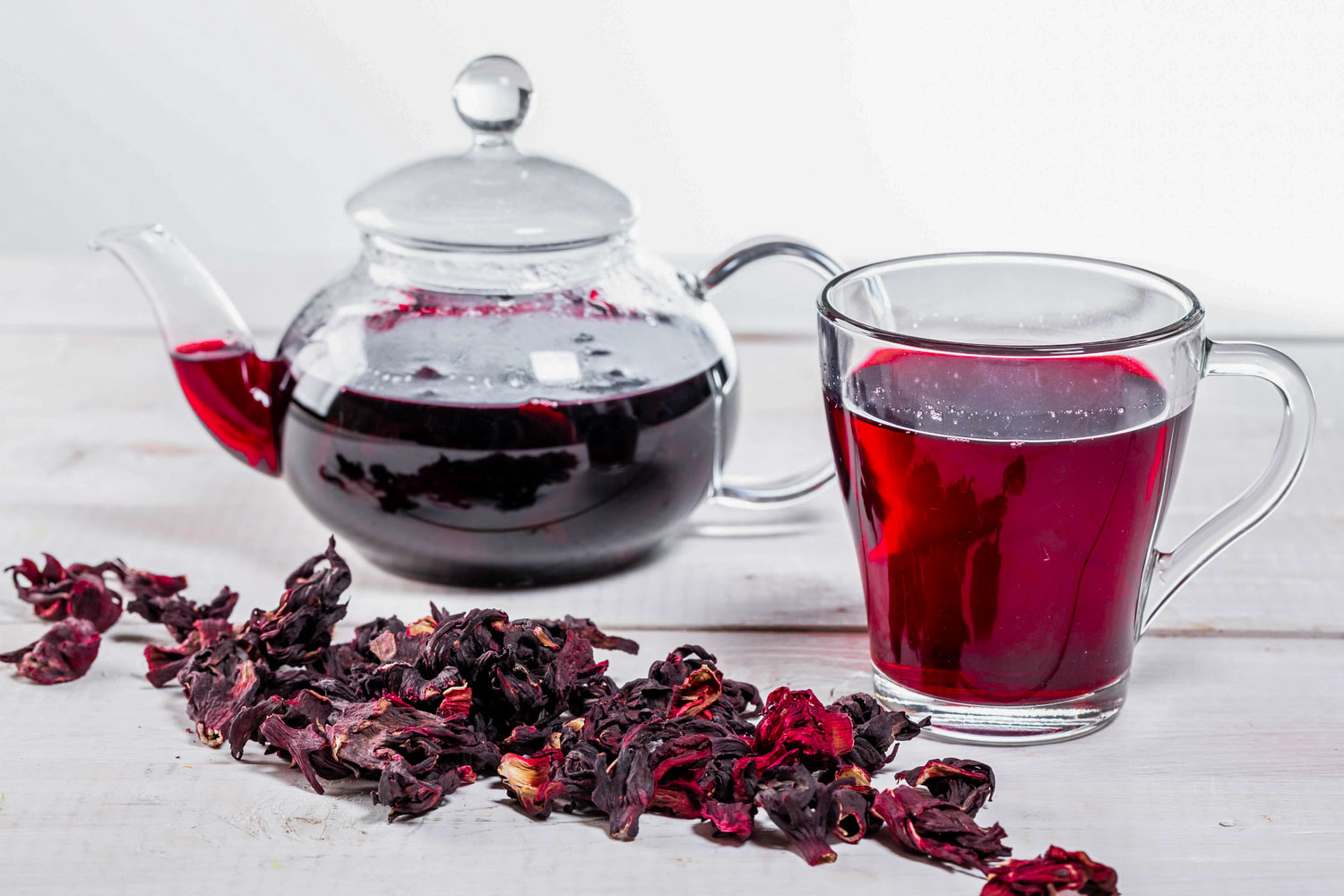 Jamaican drink sorrel tea dried flowers, tea pot and glass