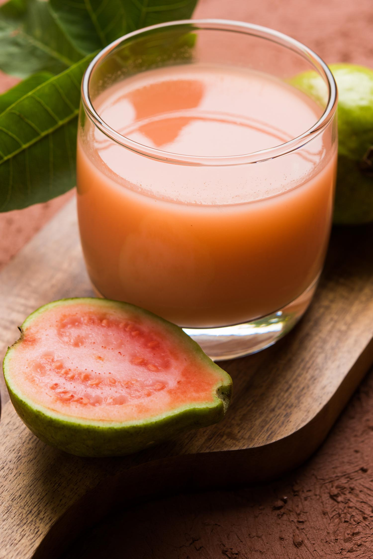 Jamaican fruit Guava juice or Amrud drink or Smoothie with fresh Guava fruit, moody lighting selective focus