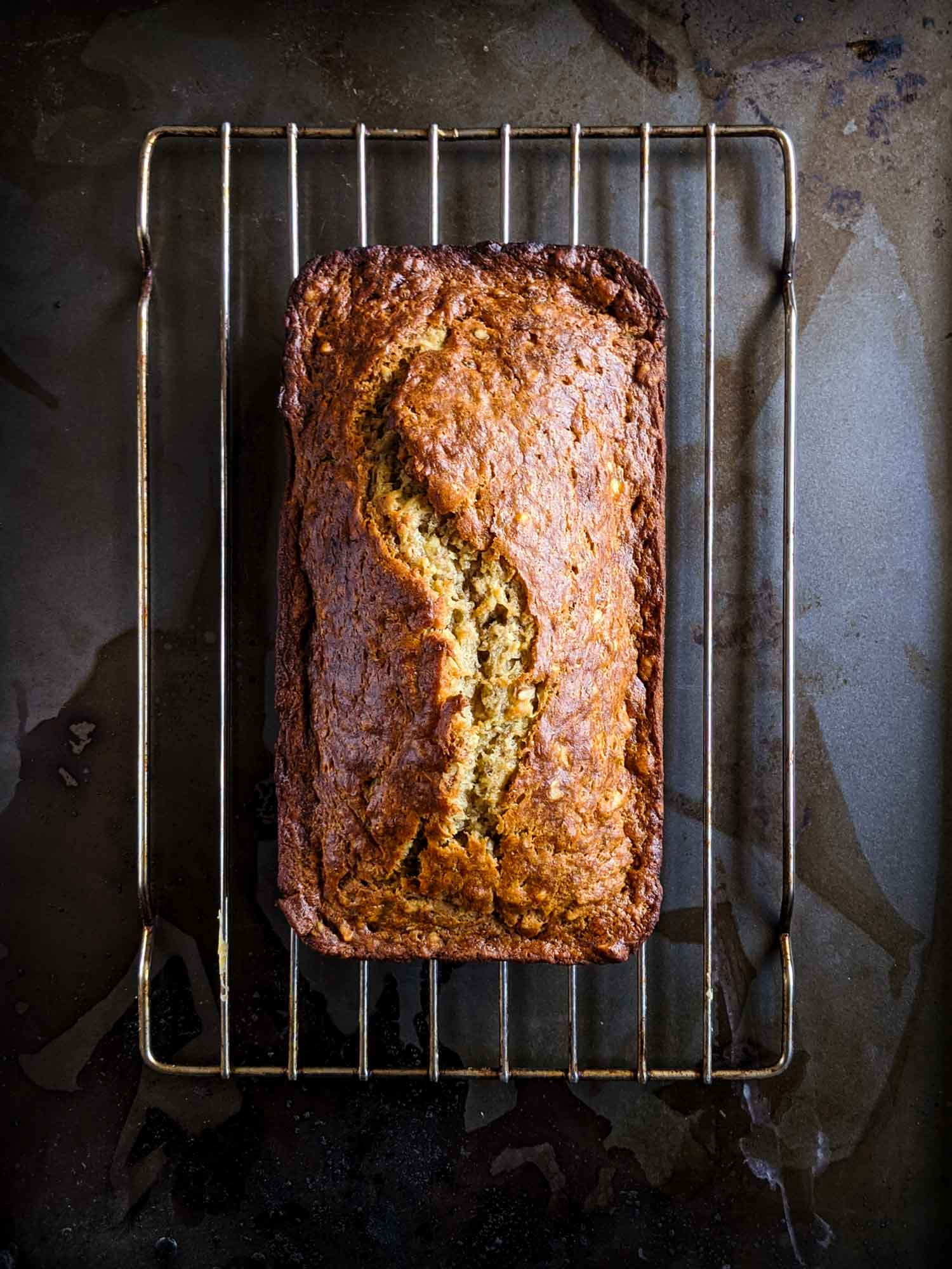 Classic banana bread recipe cooling on a wire rack