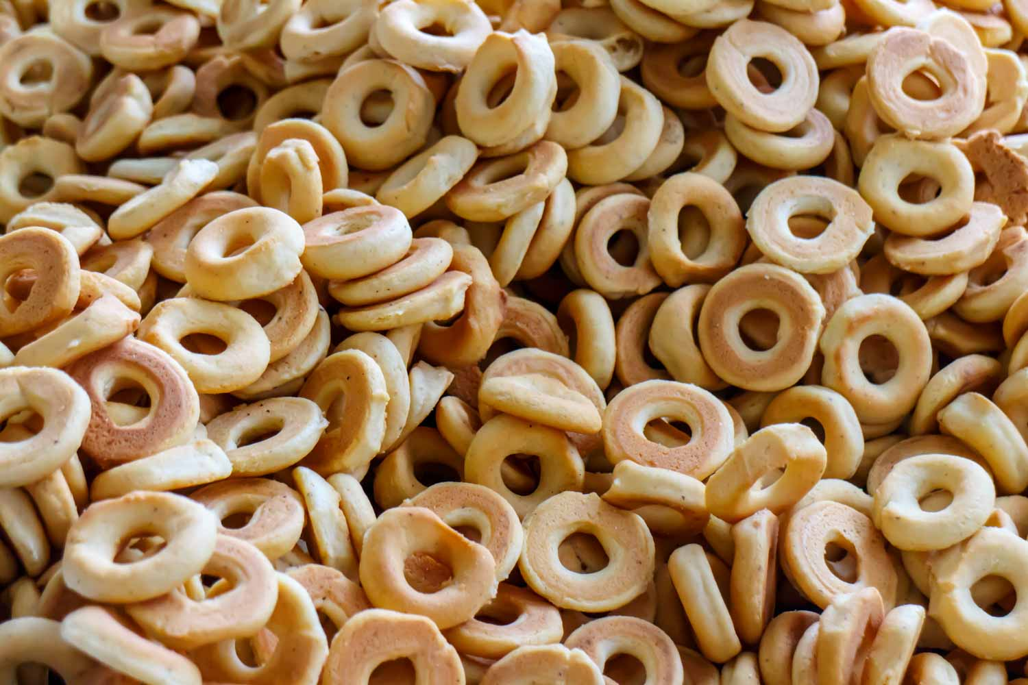 pile of typical handmade rosquillas, typical Honduran deserts that look like donuts or bagels.
