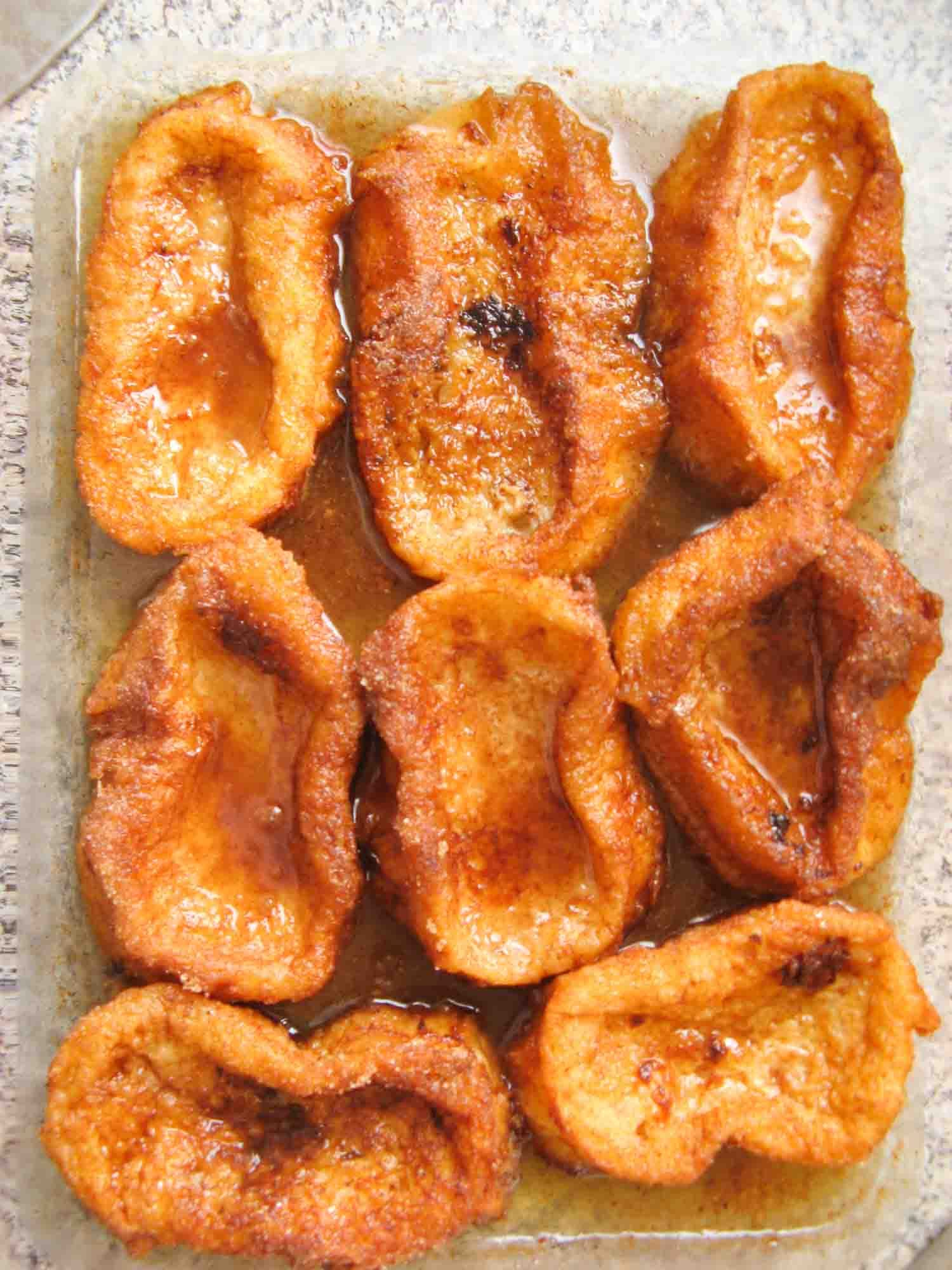 Torrejas, a Honduran dessert that are lady fingers coated in syrup, here eight on a plate