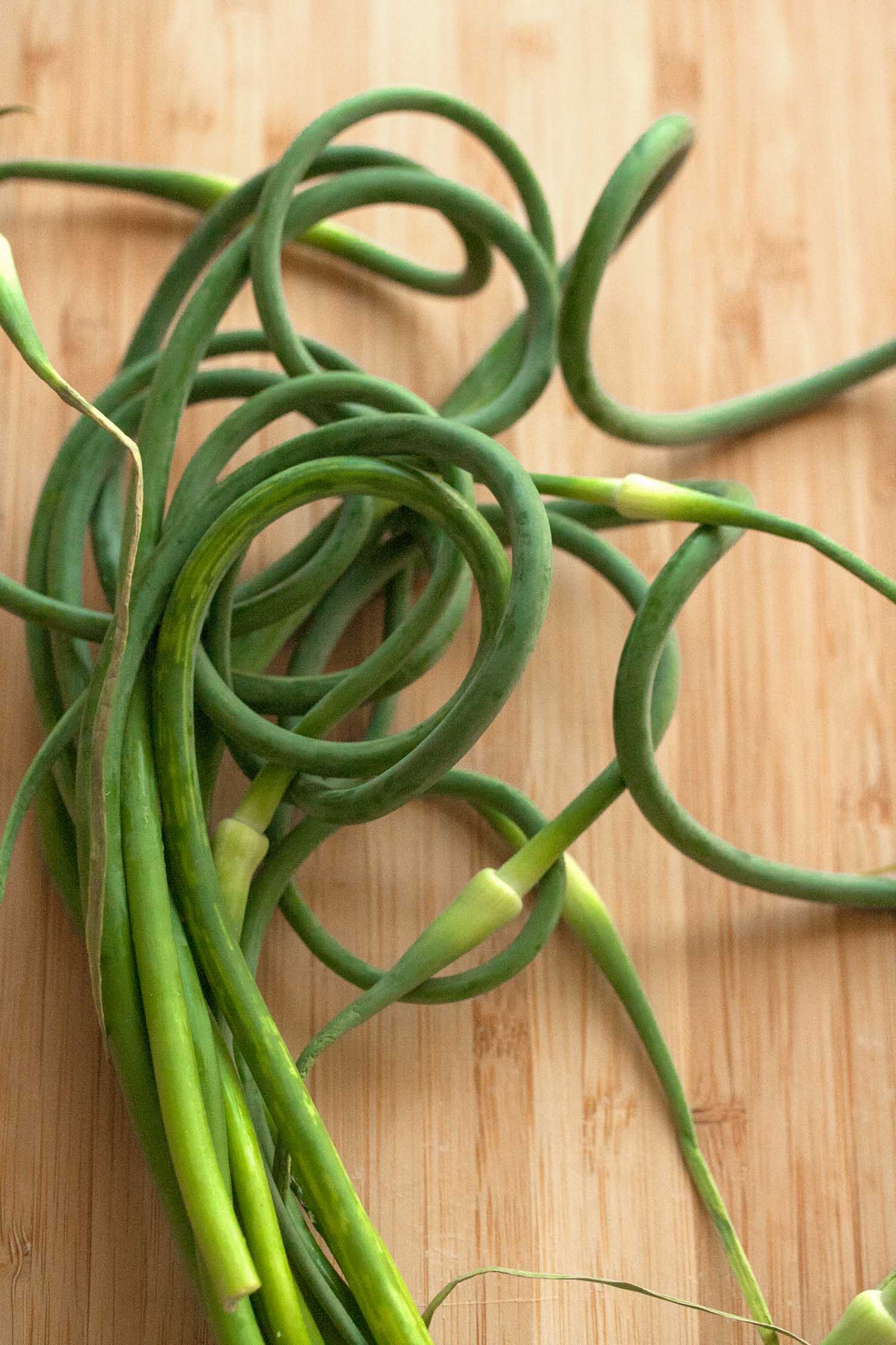 Bunch of garlic scapes on a table