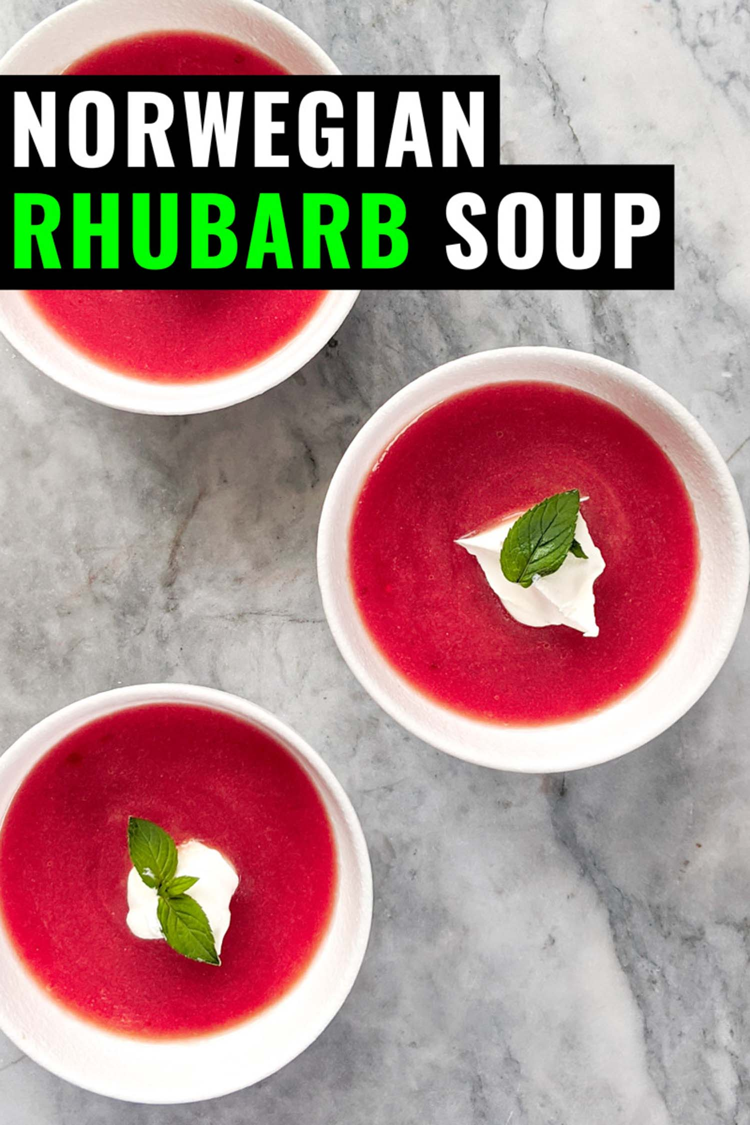 Cold rhubarb soup topped with whipped cream and mint in three white bowls on a grey marble background with text norwegian rhubarb soup