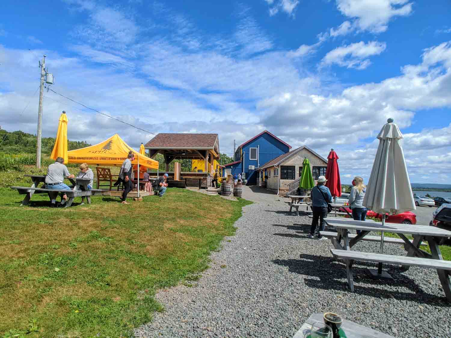 Big Spruce Brewing Company grounds with picnic tables