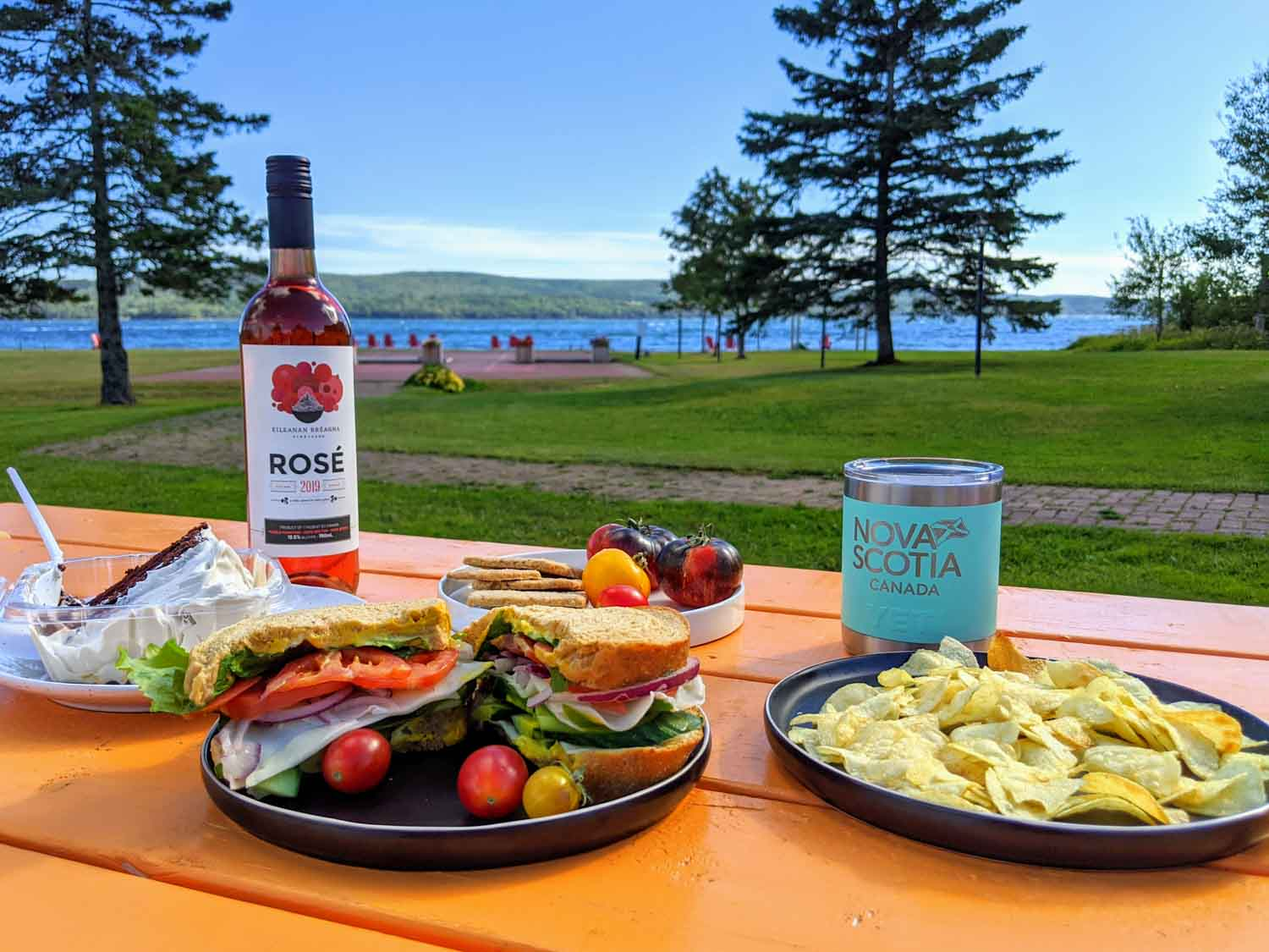 Lunch on an orange picnic table at Inverary resort in Baddeck Nova Scotia