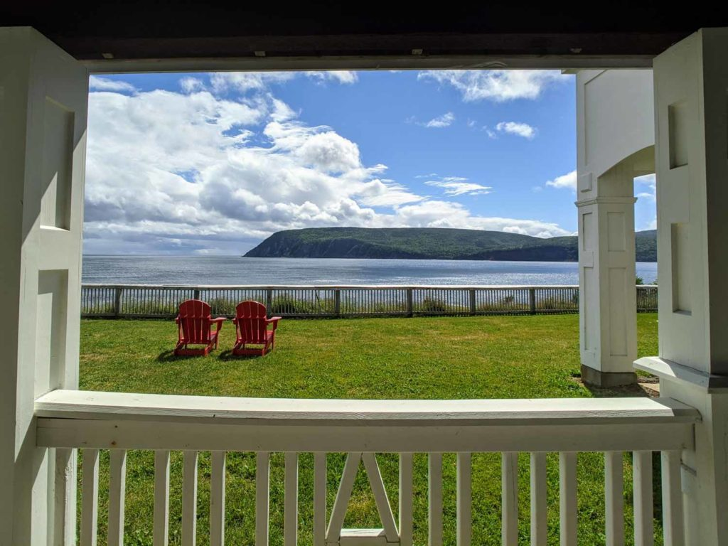 keltic lodge view looking out from room onto two adirondack chairs cape breton Nova Scotia