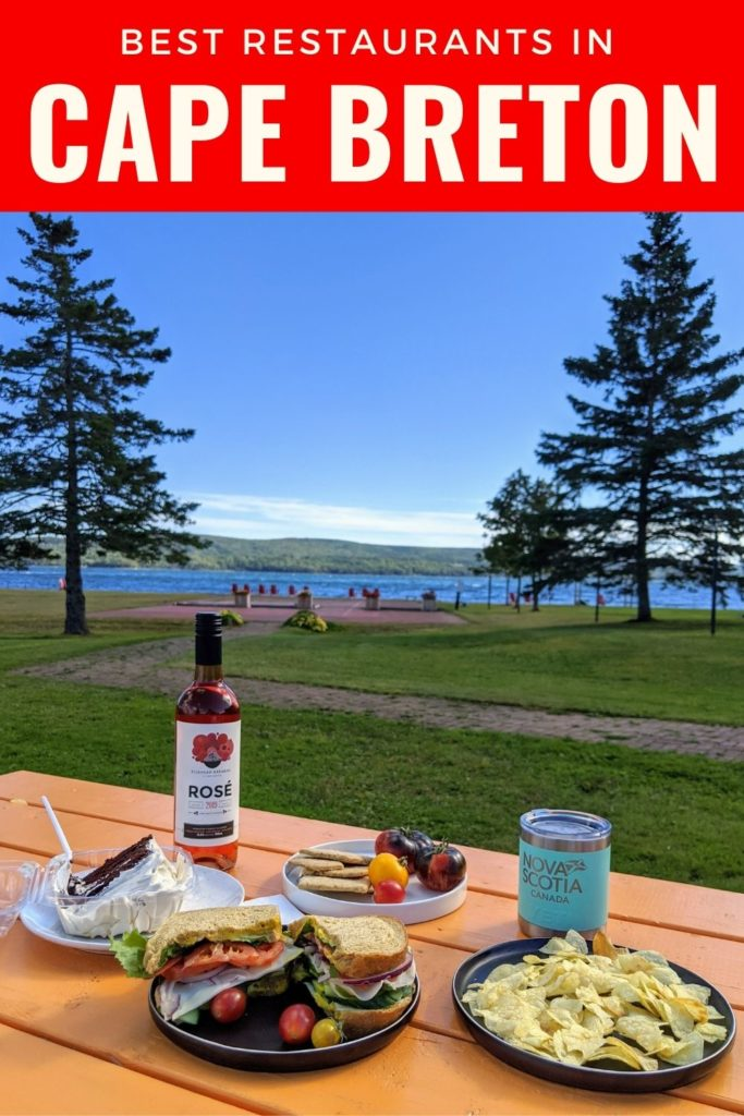 Pin for best restaurants in Cape Breton with picnic table full of local food