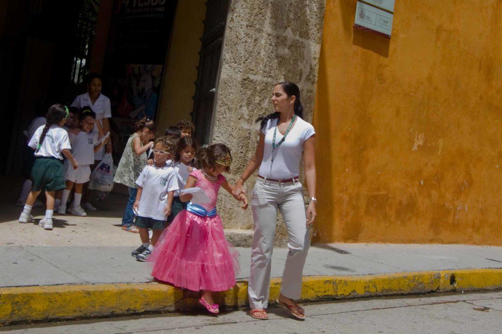 children crossing street in Cartagena Colombia