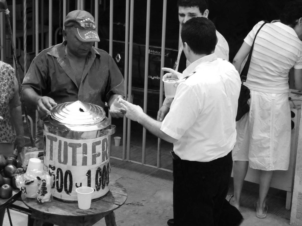 Man serving Tutifruiti drink on street in Colombia South America