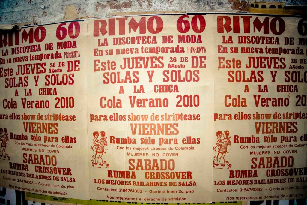 Posters on wall in Colombia for a bar and salsa dancing
