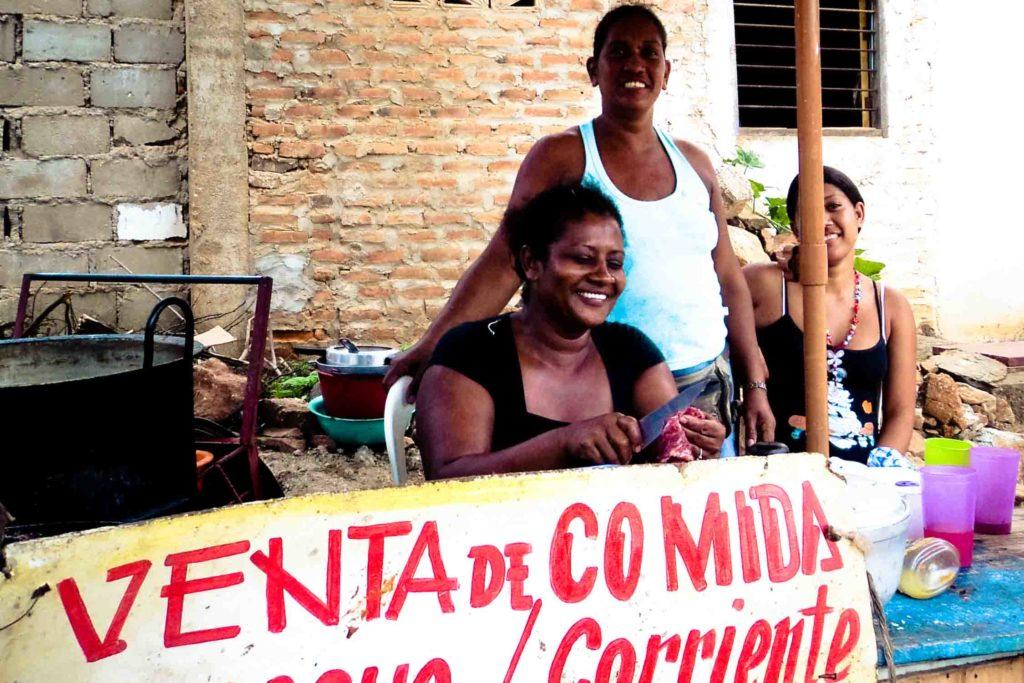 Women selling food at restaurant in Taganga