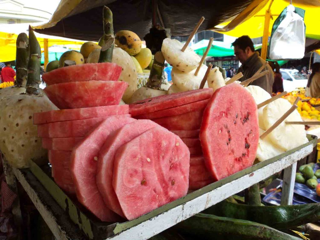 Watermelon sliced with pineapple in a Philippines fruit market