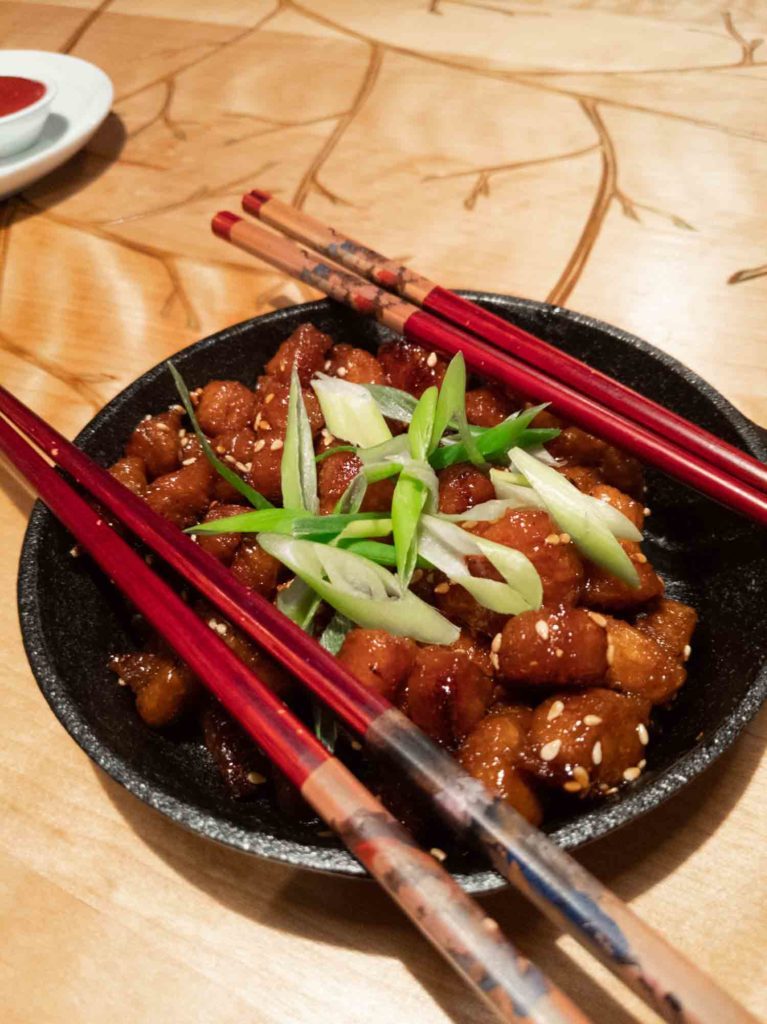 Korean tofu sticky bites in a bowl with chopsticks