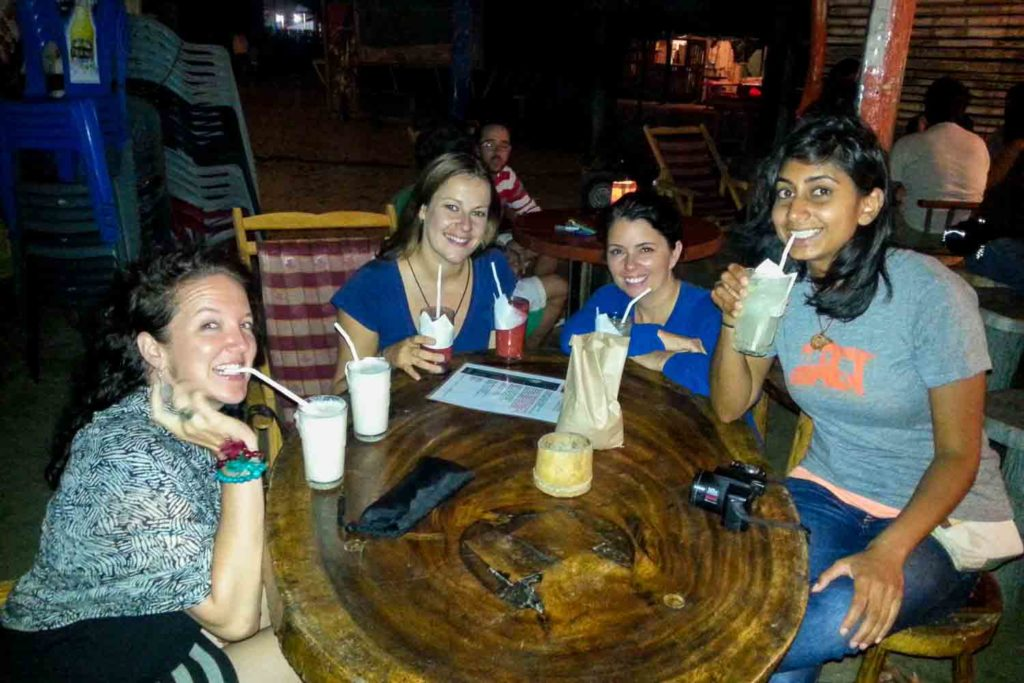 Group of women at beach bar in Canoa