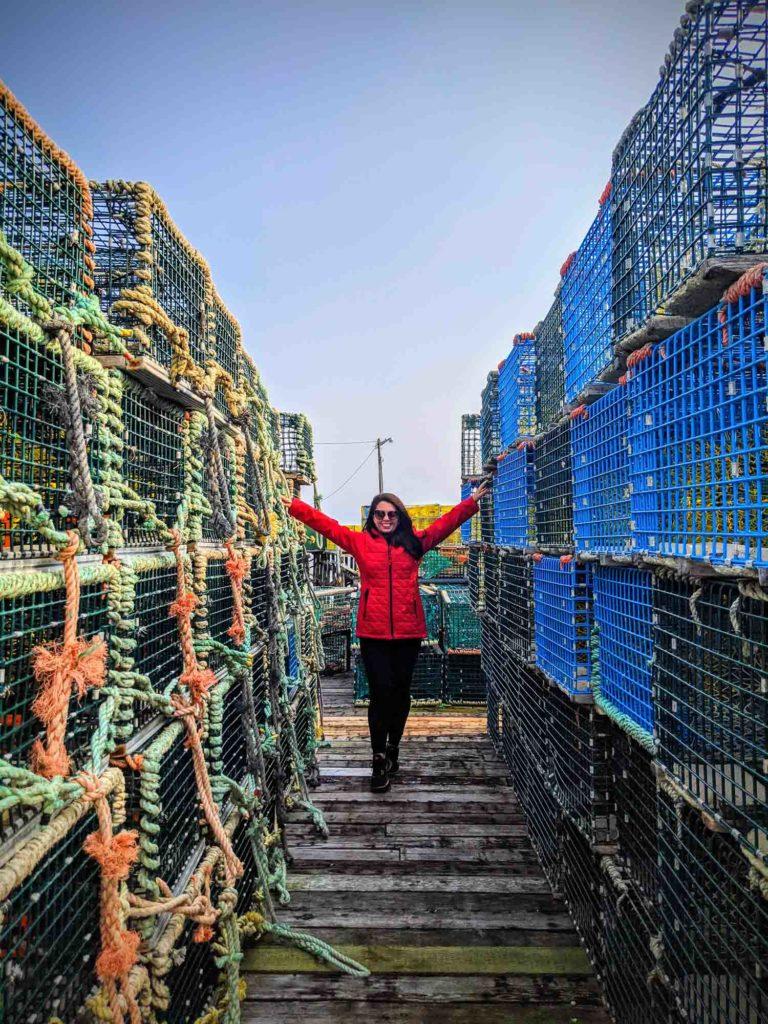 Ayngelina in between walls of lobster traps in Tusket Islands Nova Scotia