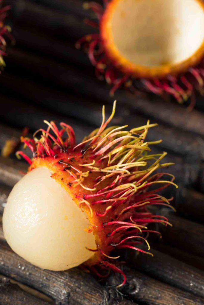Raw Red Organic Rambutan Fruit Ready to Eat known as Anchotillo in Ecuador