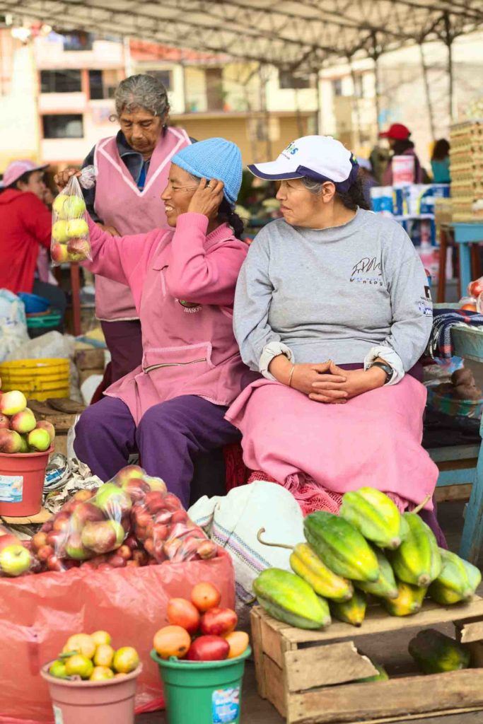 female vendors on the market on Plaza 5 de Junio on February 26 2014 in Banos Ecuador. On the market which is held every Wednesday Friday and Sunday mainly fruits and vegetables are being offered