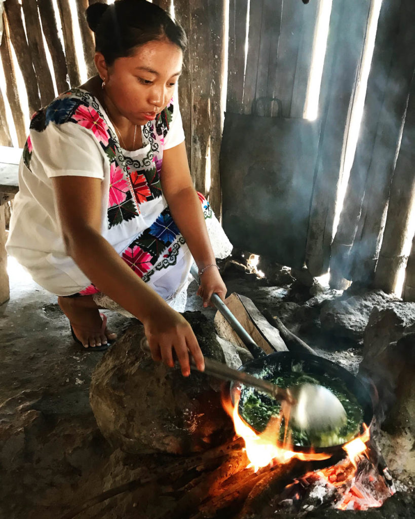 Young Mayan woman cooking in a kitchen in Mexico