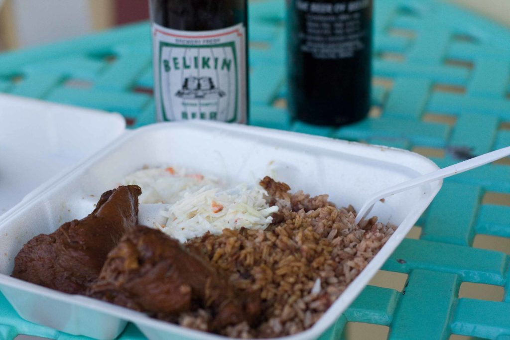 Chicken and rice with coleslaw and Belikin Beer in Belize