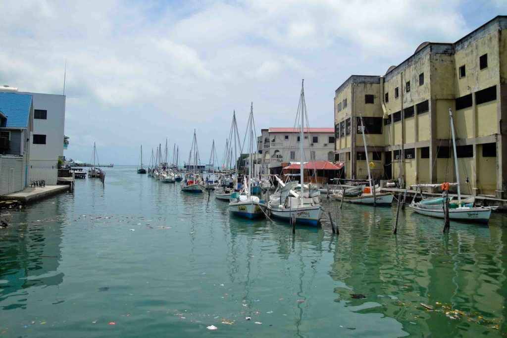 Belize City waterfront with boats in the water