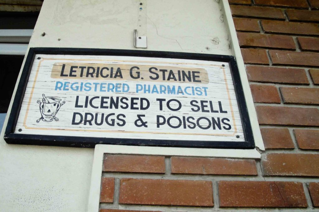 Sign than says Licensed to Sell Drugs and Poisons