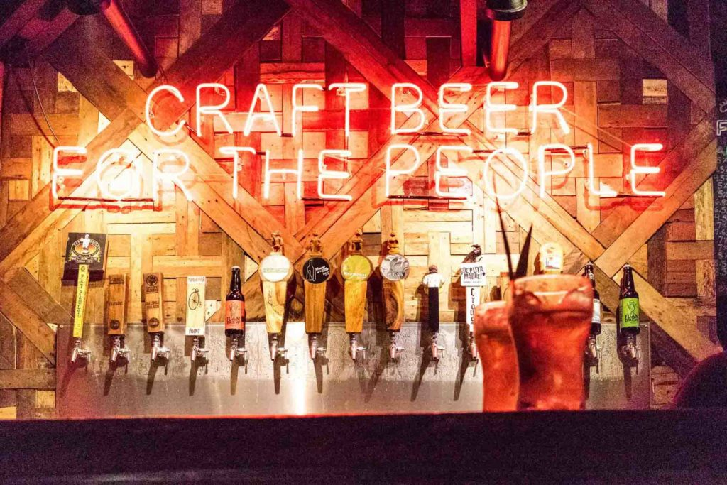 Filipino bar with beer taps, above it says Craft Beer for the People