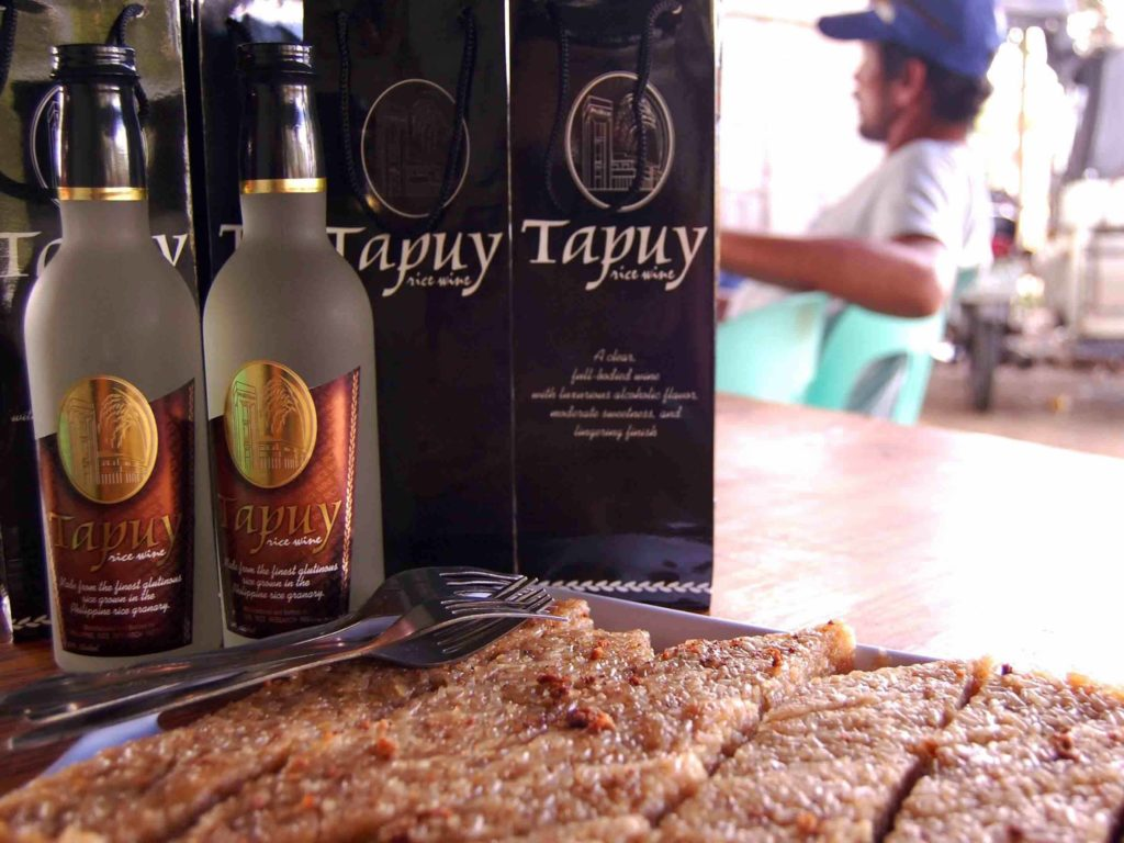 Tapuy rice wine in bottles with boxes in back