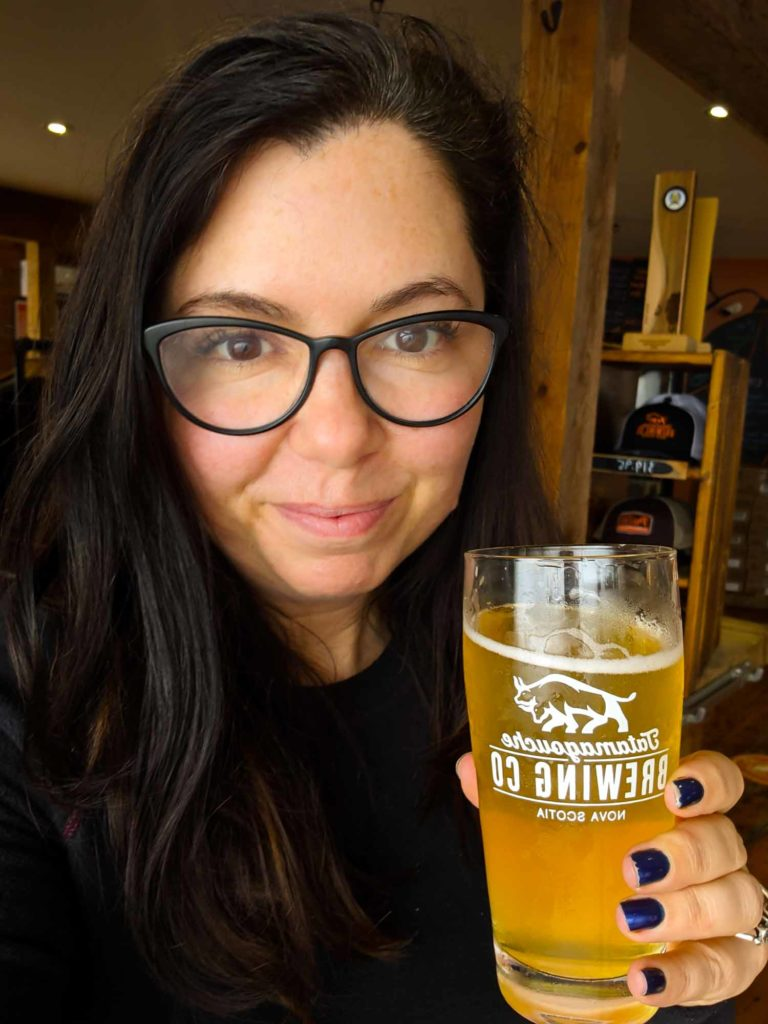 Ayngelina holding beer from Tatamagouche Brewing