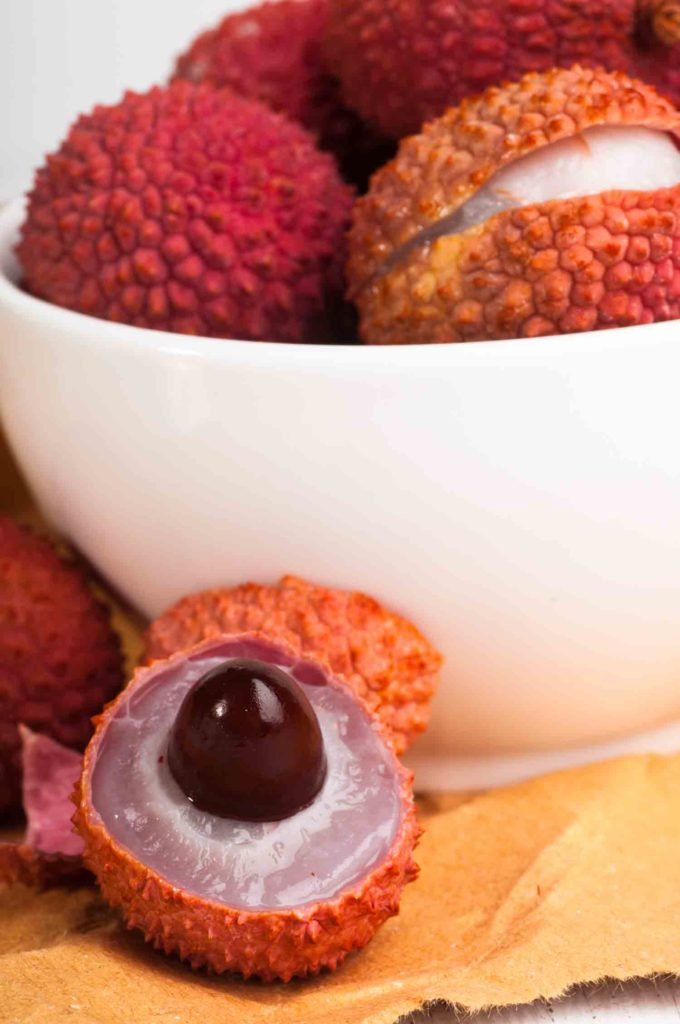 Fruit in Trinidad lychee in bowl with one opened to see interior