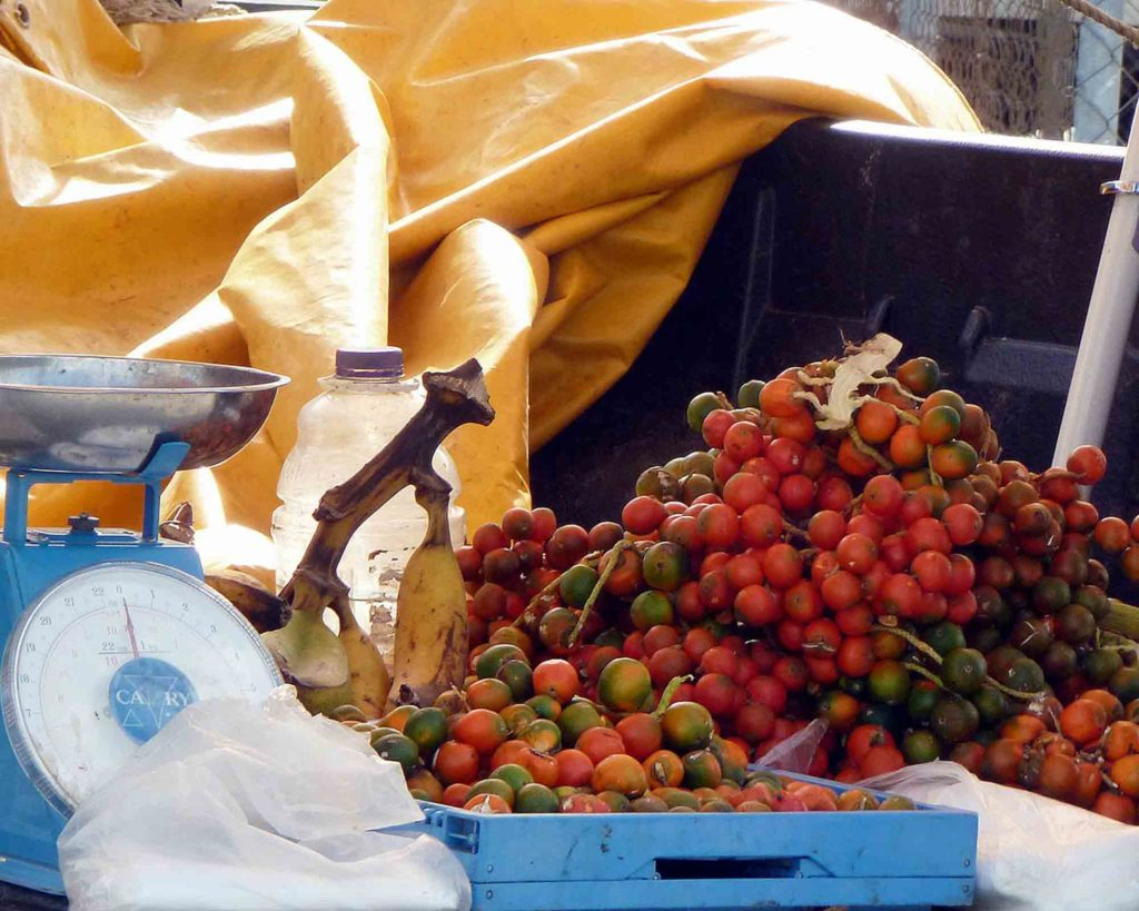 peewah fruit in Trinidad market on table next to scale