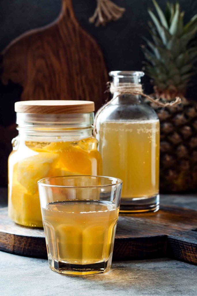 Chicha de pina Ecuadorian drink made with simmered pineapple rinds, panela or sugar and spices