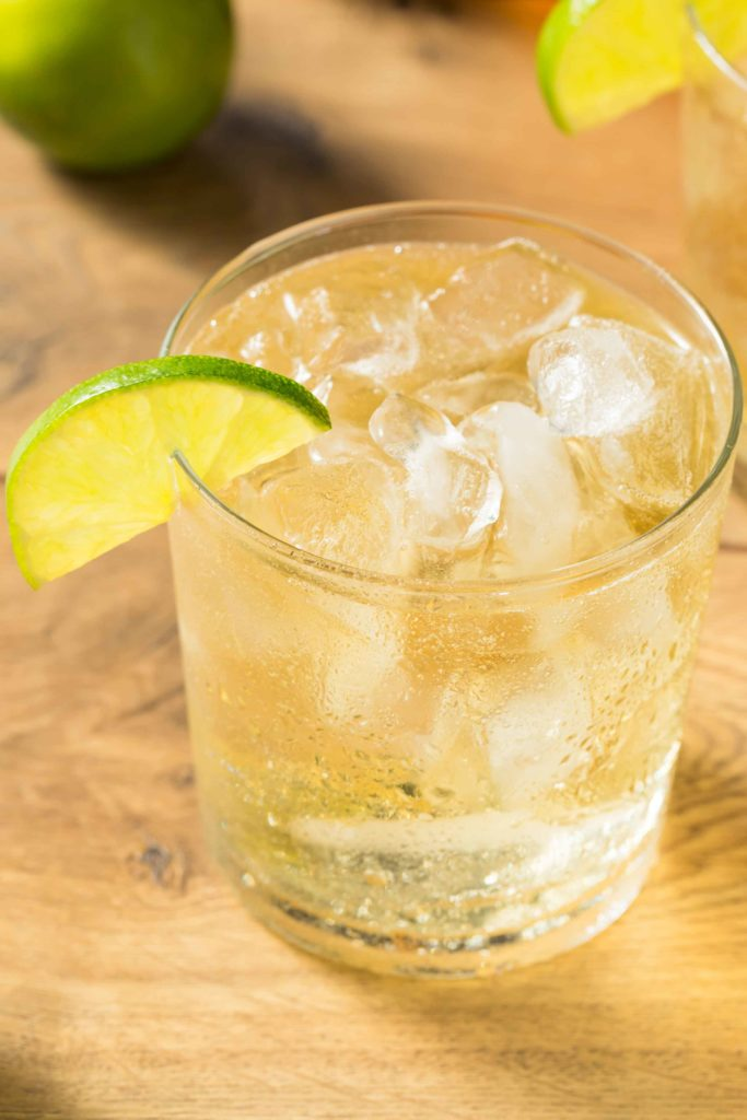 Guatemala Limonada con Soda in a glass with ice on a wooden table