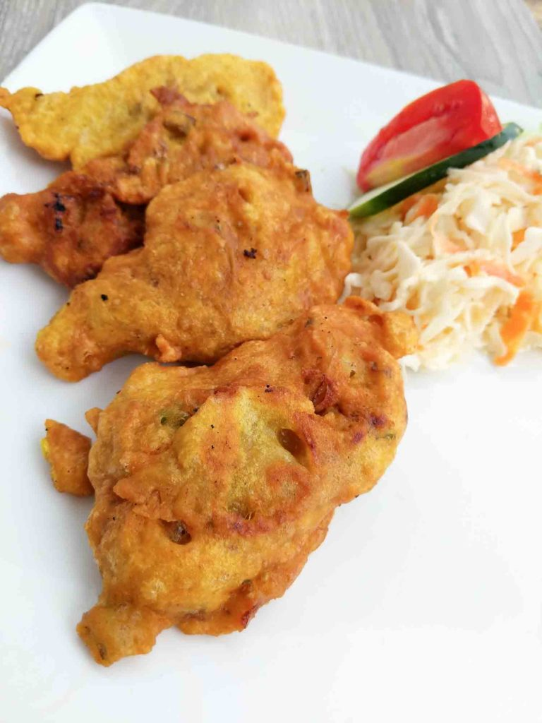 Stamp and go saltfish fritters on a white plate