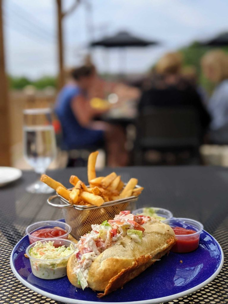 Wolostoq Warf one of the best Fredericton restaurants, lobster roll with French fries