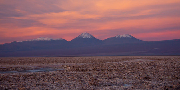 Tierra Atacama salt flats with Andes mountains in background at sunset