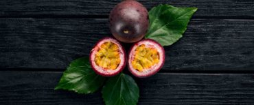 Colombia fruits Gulupa Passionfruit. Tropical Fruits. On a wooden background. Top view.